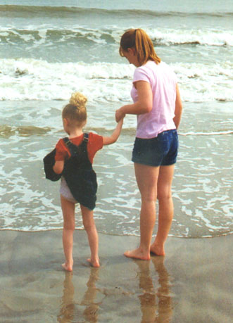 Autumn and her Aunt Colleen wading in the ocean