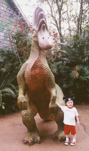 Wiley poses with another dinosaur. He REALLY likes dinosaurs!