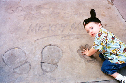 Wiley puts his hands in Mickey's handprints at MGM Studios